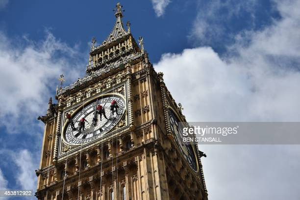 Technicians carry out cleaning and maintenance work on one of the faces of the Great Clock atop the landmark Elizabeth Tower that houses Big Ben,...