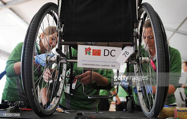 Technicians carry out repairs on a wheelchair belonging to fencer Liudmila Lemiashkevich of Belarus at the Ottobock repair workshop during the London...