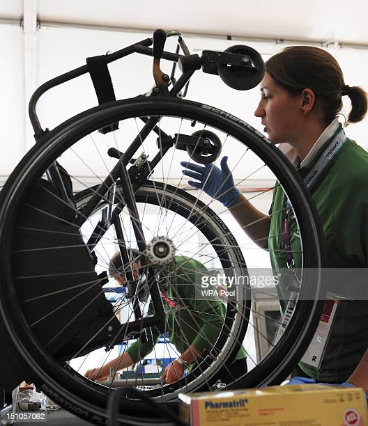 Technicians carry out repairs on an athletes' wheelchairs at the Ottobock repair workshop during the London 2012 Paralympic Games at the Paralympic...