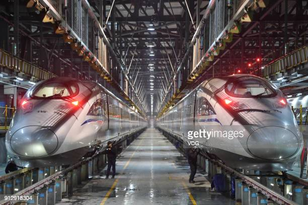 Technicians check CRH bullet trains at a maintenance base on the first day of Spring Festival travel rush on February 1 2018 in Wuhan Hubei Province...