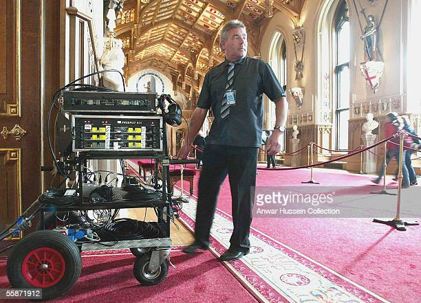 Technicians for ABC the American Broadcasting Company wheel equipment into the St George's Hall as they prepare to film a special edition of 'Good...