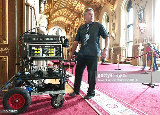 Technicians for the American Broadcasting Company, ABC, wheel equipment into St. George's Hall, October 2005, as they prepare to film a special...