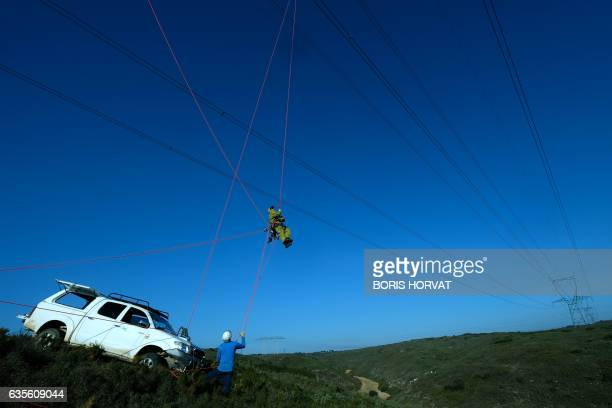 Technicians from the RTE install a sensor, capable of measuring the cooling effect of the mistral on a high-voltage line, on a 400,000 volt power...