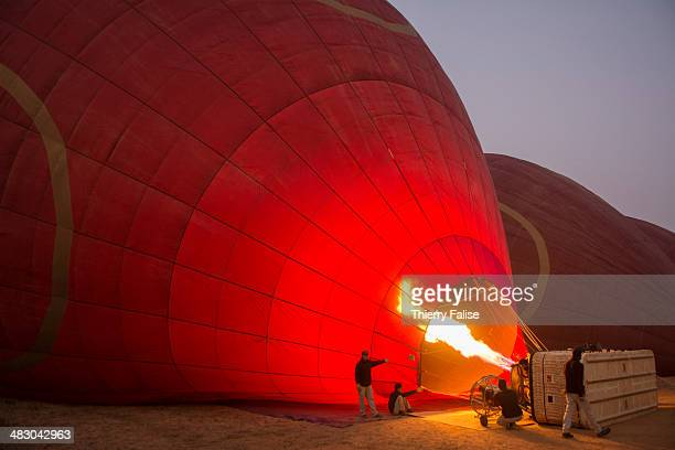 Technicians inflate a hotair balloon bound to fly over the Bagan archaeological site