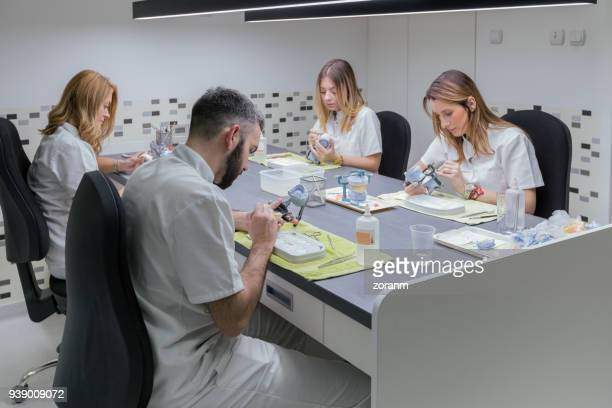 Technicians making dentures