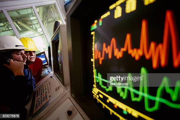 Technicians Monitoring Computer Screens
