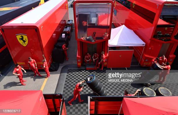 Technicians move F1 tires at Ferrari's motorhome in the paddock at the Autodromo Nazionale circuit in Monza on September 3, 2020 ahead of the Italian...