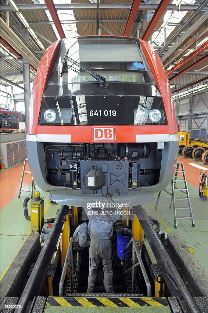 Technicians of the DB Regio AG, a subsidiary of Germany's national rail company Deutsche Bahn, work on the regular inspection of a railcar in the repair and assembling shop of the Deutsche Bahn in Erfurt, east-central Germany on April 23, 2010.