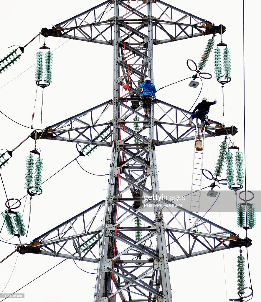 Technicians of the Electricity Transmiss Pictures | Getty Images