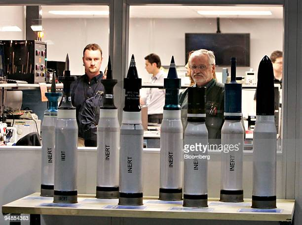 Technicians stand in the control center behind U.S. Army 120mm shells during a Future Combat Systems cannon demonstration at the General Dynamics...
