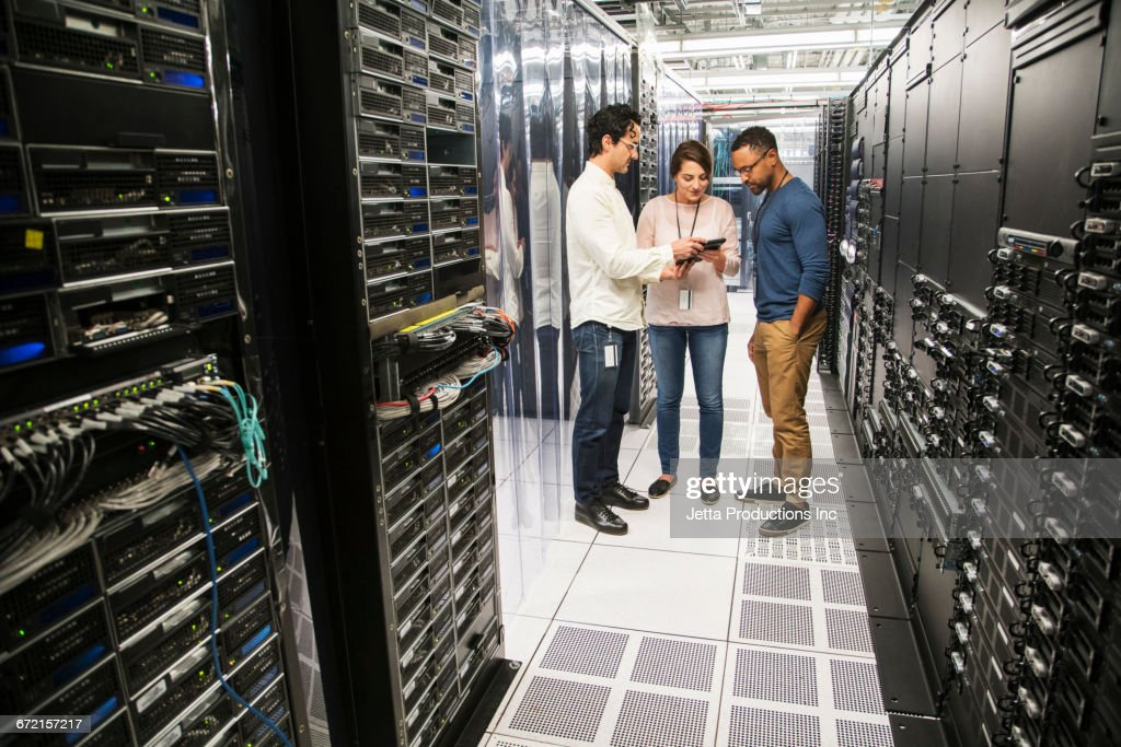 Technicians Using Digital Tablet In Computer Server Room Stock Photo ...