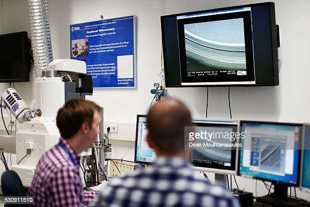 Technicians using electron microscopes work in the Materials and Processes Division / Materials and Electrical Components Laboratory at the European...