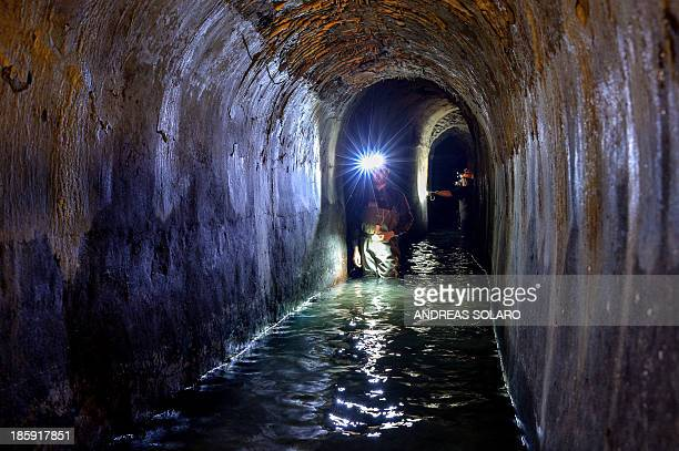 THUBURN Technicians walk in the 'Snail of the Villa Medici' the Acqua Vergine aqueduct one of the 11 roman aqueducts which supply almost all of the...