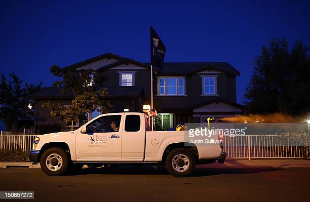 Technicians with the Contra Costa County Mosquito and Vector Control District drive a truck through a neighborhood fogging with Pyrocide 7396...