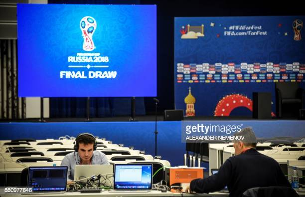 Technicians work at the FIFA World Cup 2018 Final Draw media centre at the State Kremlin Palace in downtown Moscow on November 28 2017 / AFP PHOTO /...