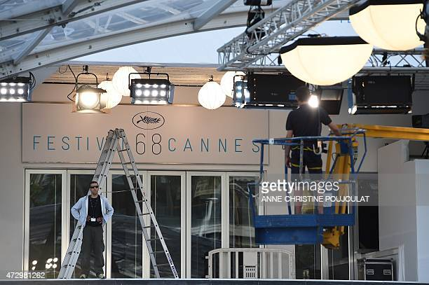 Technicians work in front of Festival palace before the 68th Cannes' film festival on May 11 2015 in Cannes southeastern France AFP PHOTO /...