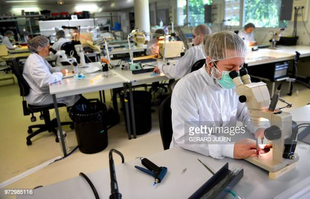 Technicians work in the production unit of stents and catheters of the BALT company in Montmorency on June 7 2018 Since it was established in 1977...