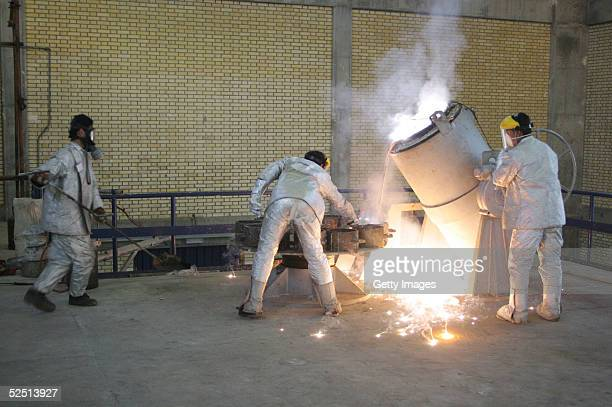 Technicians work inside of a uranium conversion facility producing unit March 30, 2005 just outside the city of Isfahan, about 254 miles , south of...