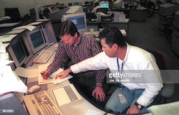 Technicians work January 15, 2001 inside California's Independent System Operator facility control center located in Folsom, Ca. And which acts as a...