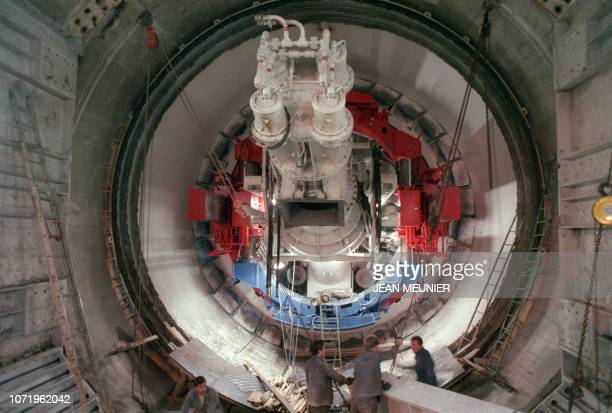 Technicians work near the tunnel boring machine , on the construction site of the Channel tunnel in Sangatte, on January 30, 1988.