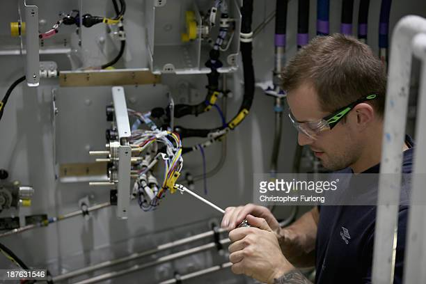 Technicians work on an Airbus A380 wing during construction at the Airbus SAS factory on November 7 2013 in Broughton United Kingdom The Airbus wing...