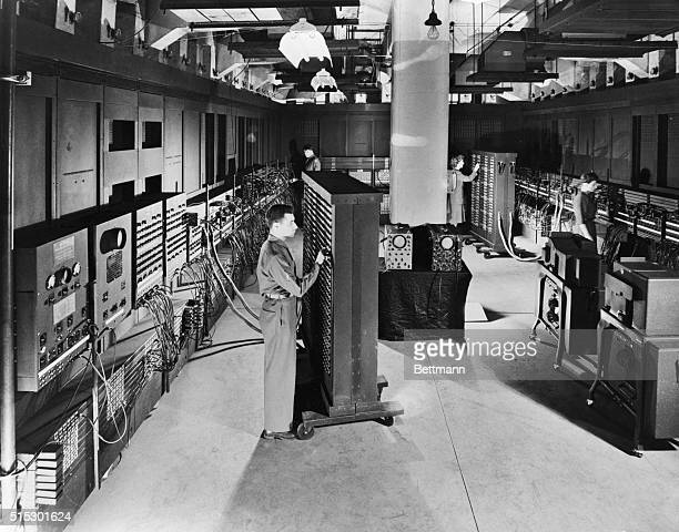 Technicians work on ENIAC the world's first electronic digital computer preparing it to solve a hydrodynamical problem