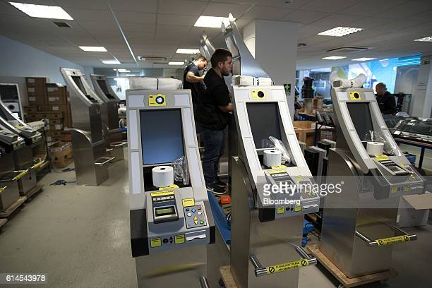Technicians work on the assembly of vb epass Kiosk used for live biometric enrollment at the VisionBox Solucoes De Visao Por Computador SA offices in...