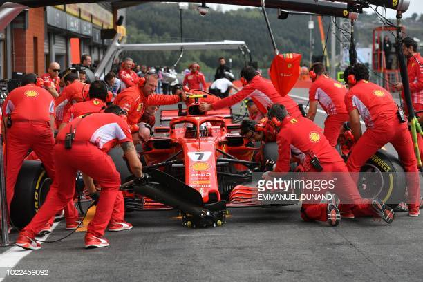 TOPSHOT Technicians work on the car of Ferrari's Finnish driver Kimi Raikkonen in the pits during the second practice session at the SpaFrancorchamps...