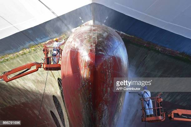 Technicians work on the MSC ORCHESTRA cruise boat in the forme 10 repair basin that reopens after 15 years on October 25 2017 in Marseille's...