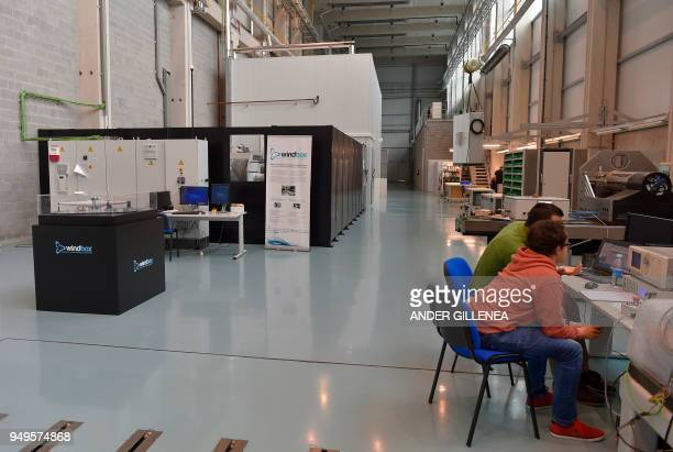 Technicians work with the test bench of Windbox project in the Spanish Basque city of Eibar on April 20 2018