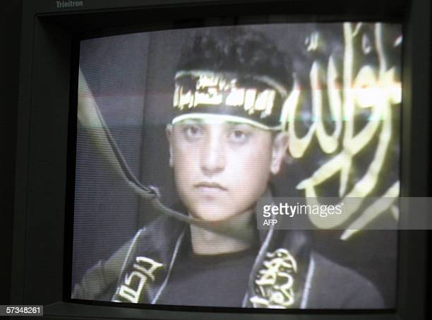 Technicians working for a media company run the video tape showing suicide bomber Sami Salim Hamadah giving his last testimony prior to blowing...