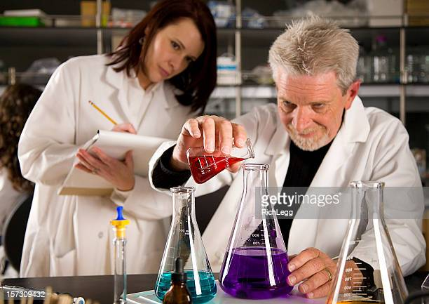 technicians working in a laboratory - rich_legg stock photos and pictures