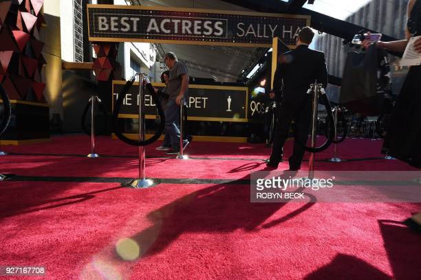 Techniciqns qnd TV crews rehearse and get ready on the red carpet a few hours before the 'Oscars' the 90th Annual Academy Awards on March 4 in...