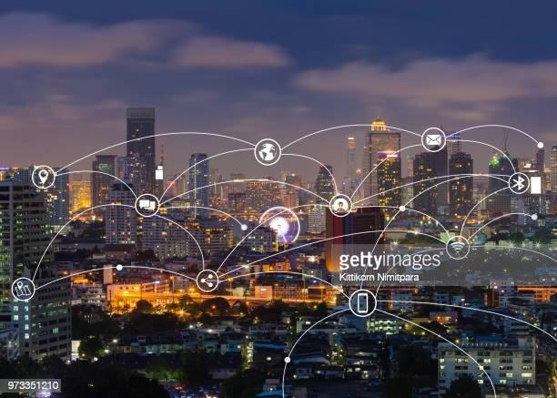 technology and communication icon over cityscape.network and connection concept. - イメージ転送 ストックフォトと画像