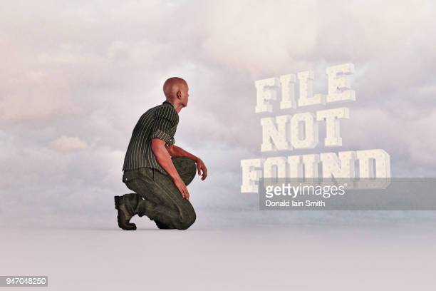 Technology error concept: man kneeling before glowing floating letters reading 'file not found'