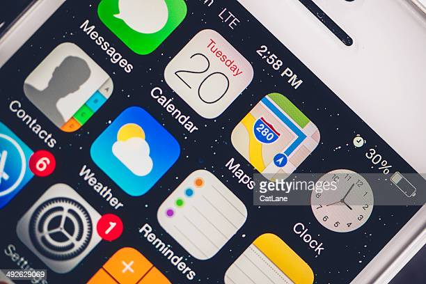 technology: iphone5 showing apps - calendar icon stock photos and pictures