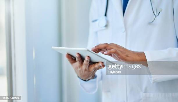 technology is of great help in the medical world - clinic stock pictures, royalty-free photos & images