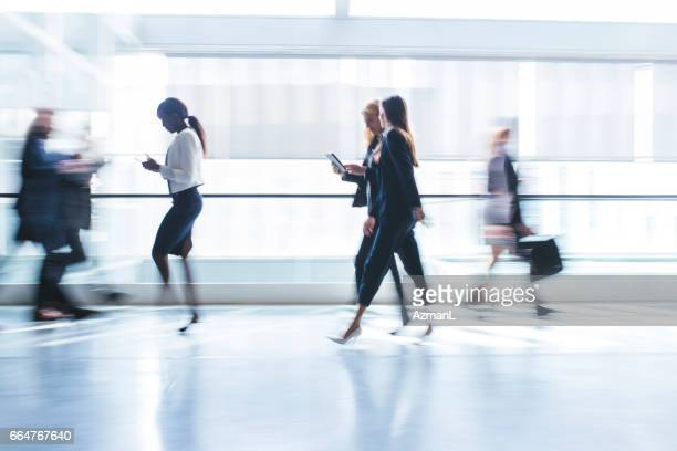 technology is part of their business day - motion blur stock photos and pictures