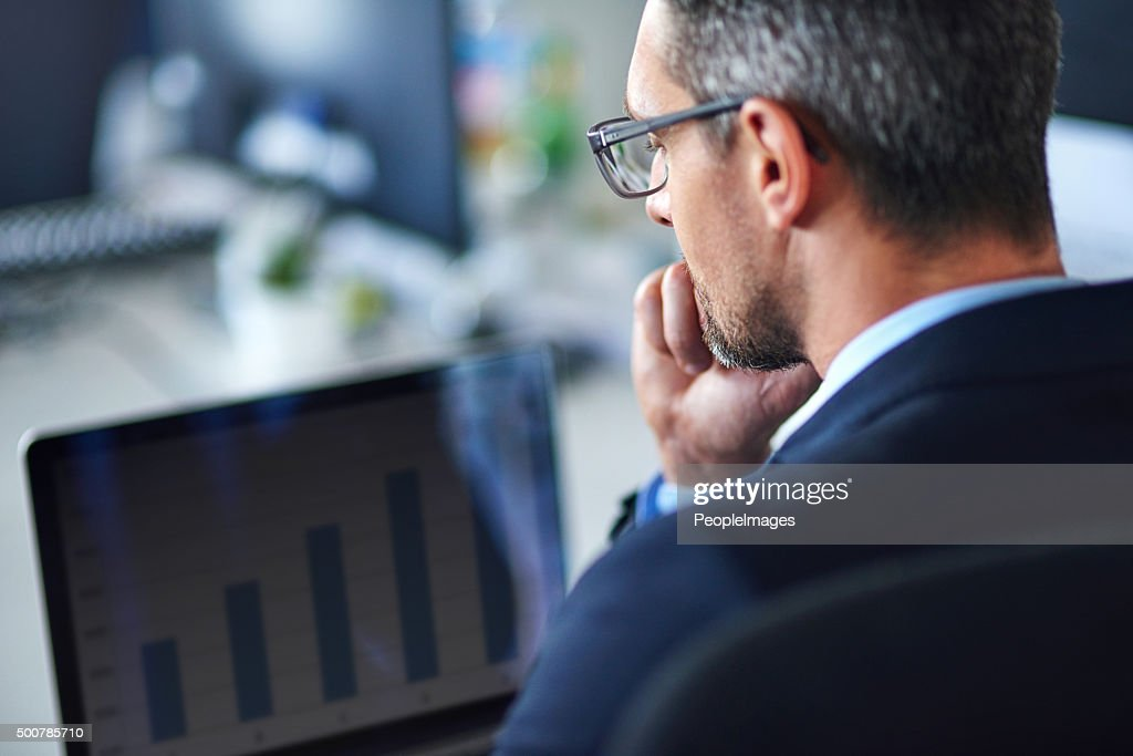 Technology keeps him current and connected : Stock Photo