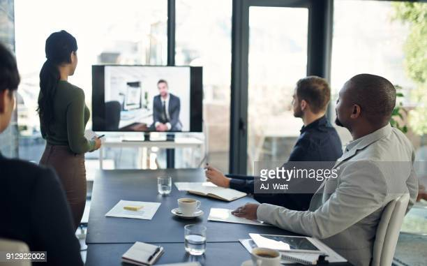 technology makes collaboration a breeze - video conference stock pictures, royalty-free photos & images