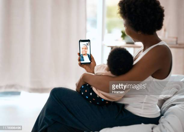 technology makes it easier to connect with your loved ones - facetime stock pictures, royalty-free photos & images