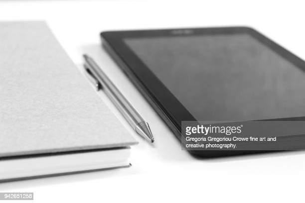 technology - notepad, pen, tablet - gregoria gregoriou crowe fine art and creative photography stock-fotos und bilder