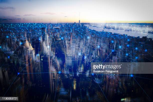 technology smart city with network communication internet of thing.  internet concept of global business in new york, usa. - techniek stockfoto's en -beelden