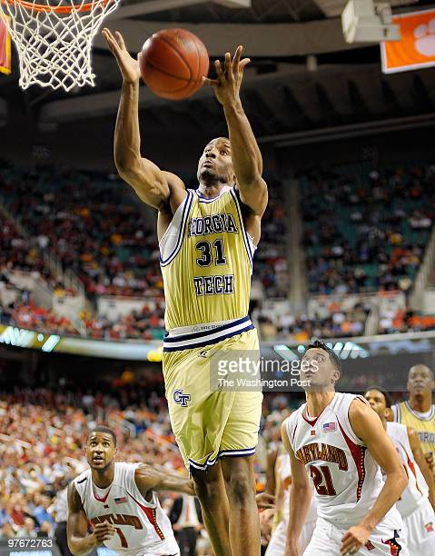 Tech's Gani Lawal gather in a rebound over Maryland's Greivis Vasquez as Georgia Tech defeats the University of Maryland 69 - 64 in the quarter...