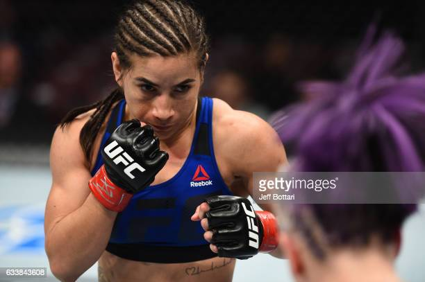 Tecia Torres circles Bec Rawlings of Australia in their women's strawweight bout during the UFC Fight Night event at the Toyota Center on February 4...