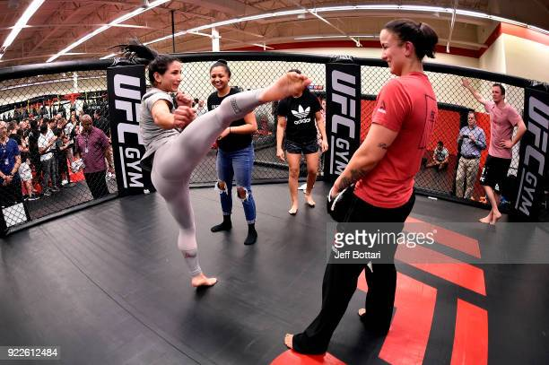 Tecia Torres invites a fan to train with at UFC GYM Orlando on February 21 2018 in Orlando Florida