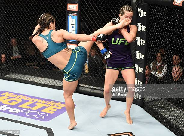 Tecia Torres kicks Angela Magana in their strawweight fight during The Ultimate Fighter Finale event inside the Pearl concert theater at the Palms...