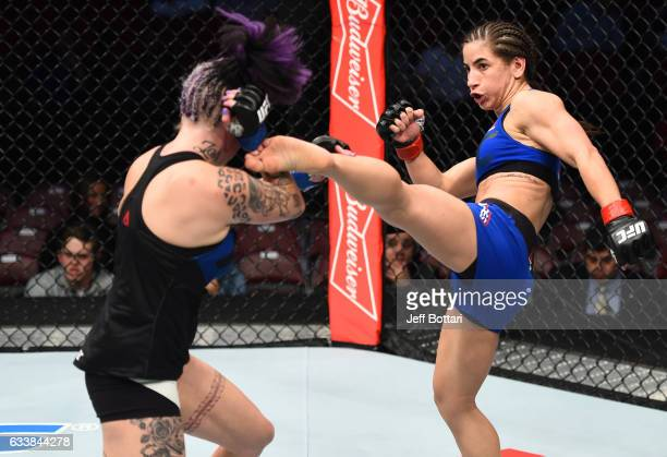 Tecia Torres kicks Bec Rawlings of Australia in their women's strawweight bout during the UFC Fight Night event at the Toyota Center on February 4...