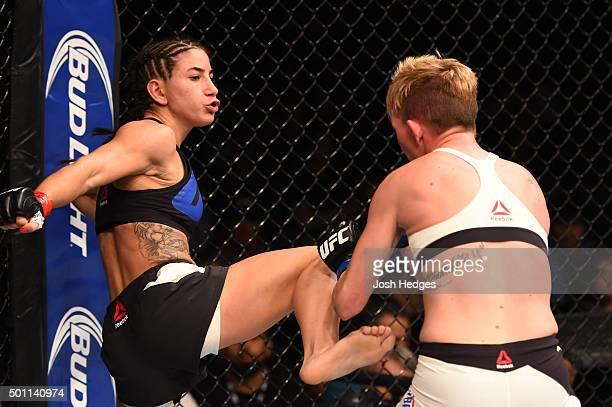 Tecia Torres kicks Jocelyn JonesLybarger in their women's strawweight bout during the UFC 194 event inside MGM Grand Garden Arena on December 12 2015...