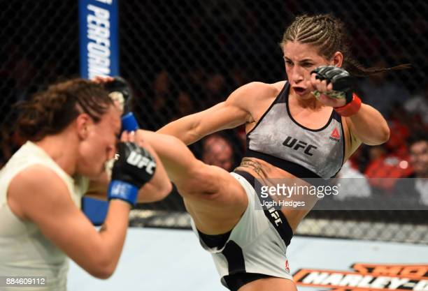 Tecia Torres kicks Michelle Waterson in their women's strawweight bout during the UFC 218 event inside Little Caesars Arena on December 02 2017 in...